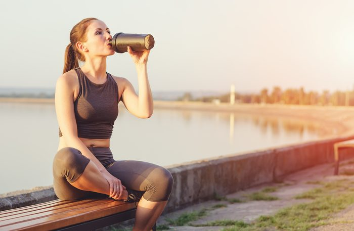 maximize your workout_woman drinking protein shake