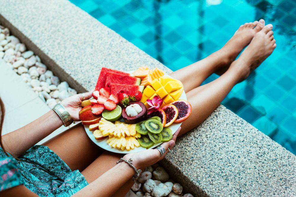 woman eating healthy fruit