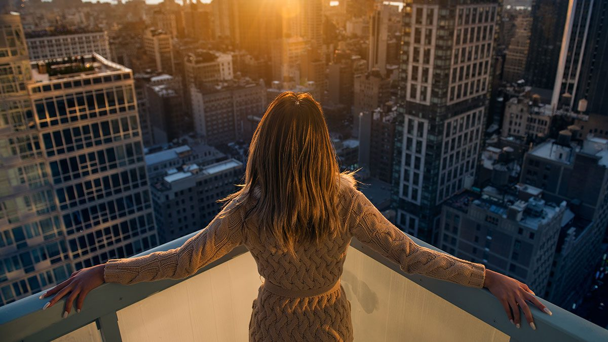 Successful people, woman standing on building