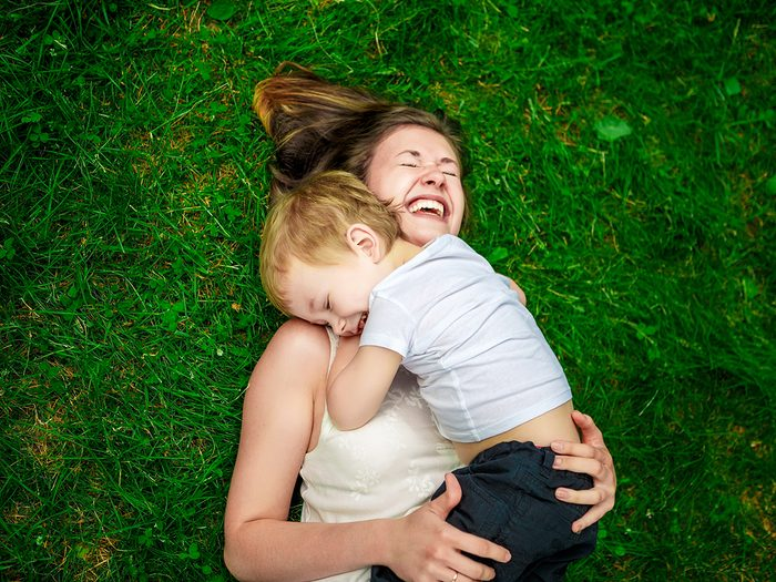 Cute,cheerful,child,with,mother,play,outdoors,in,park