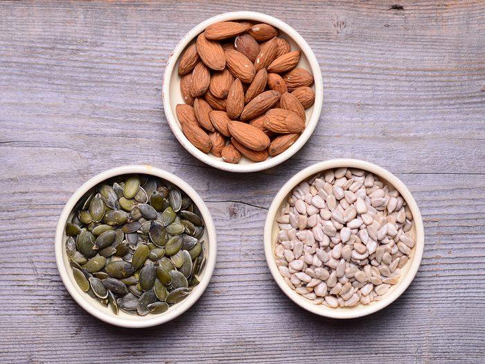Snacks, bowls of almonds, sunflower seeds and pumpkin seeds