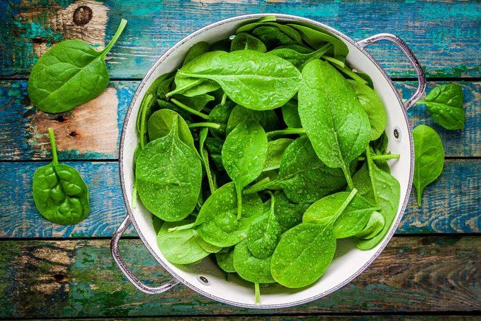 Vegetables, collander of wet spinach