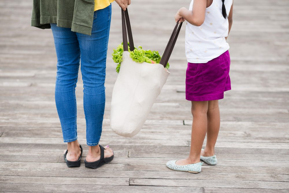 woman holding reuseable tote bag