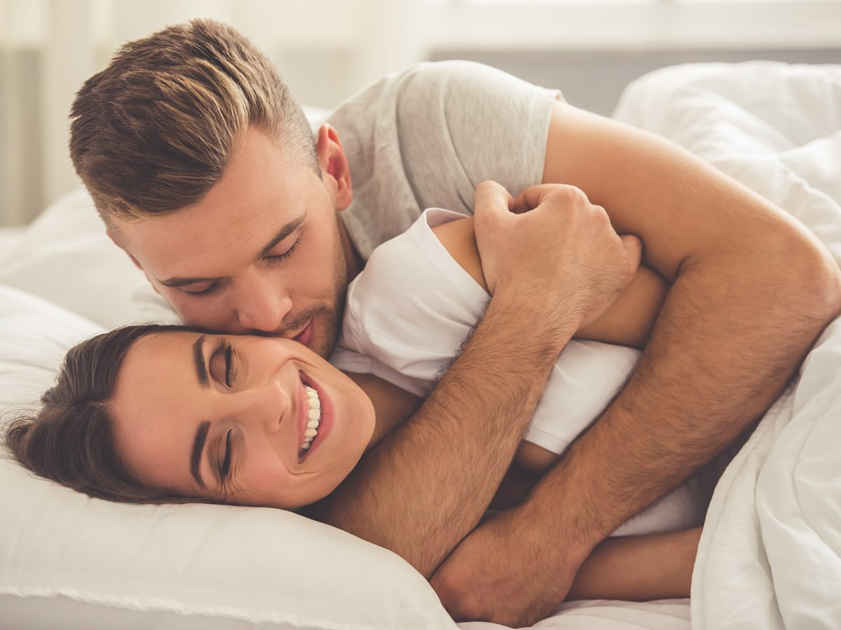 Gynecologist, couple cuddling in bed