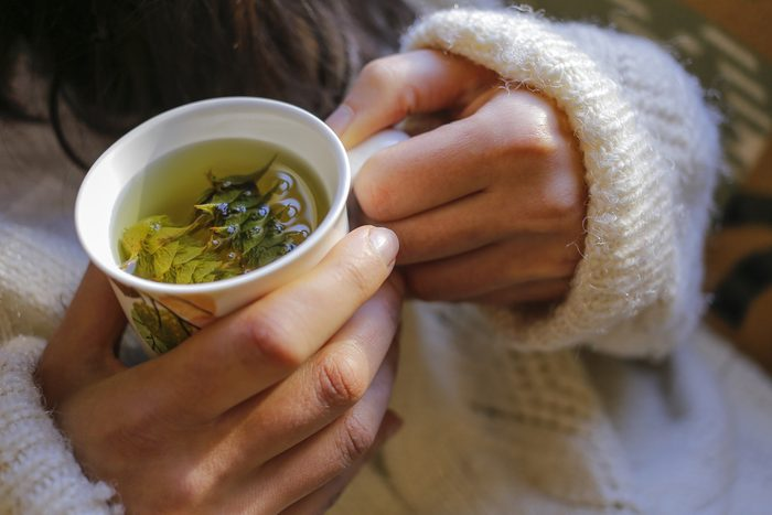 stay healthy during the holidays - holding tea