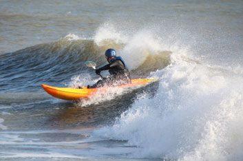 Surf kayaking and waveskiing