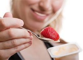 woman eating yogurt