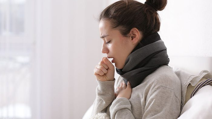 When to call in sick, woman coughing