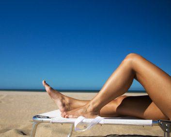 legs on beach