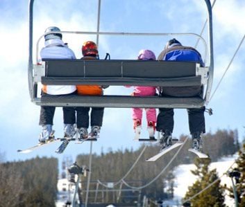 family on chair lift