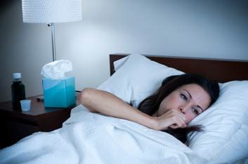 woman in bed with cough