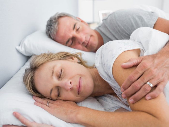 You wake up and fall asleep when your partner does.