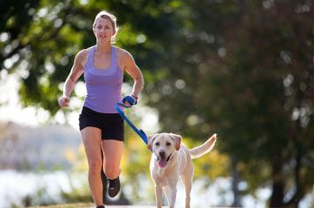 woman running with dog fitness