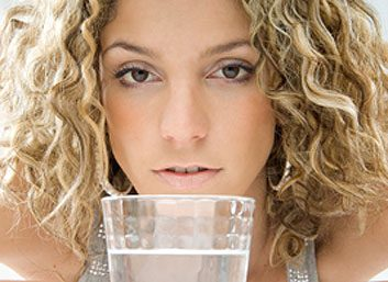Woman with a glass of water