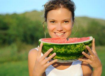 woman eating watermelon