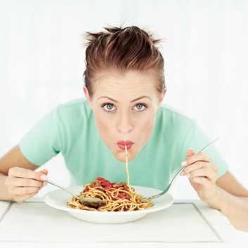 heartburn pasta woman eating