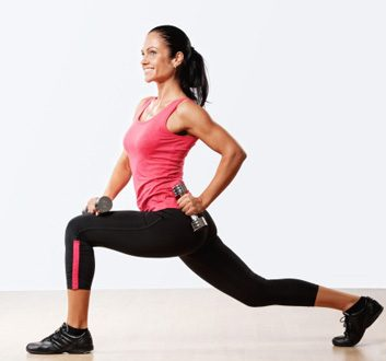woman fitness lunge dumbbells