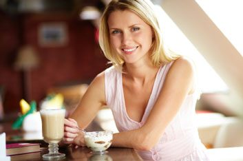 woman eating coffee snack