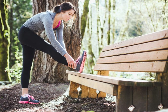 prevent spring fitness injuries _ woman stretching
