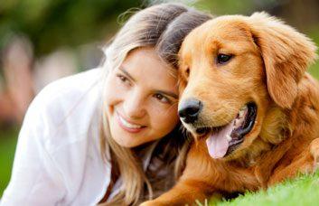 women with dog happy