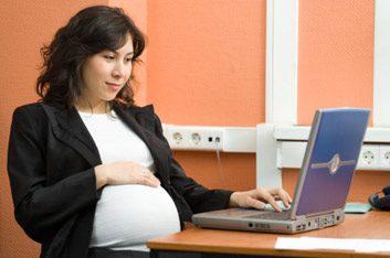 pregnant woman at laptop