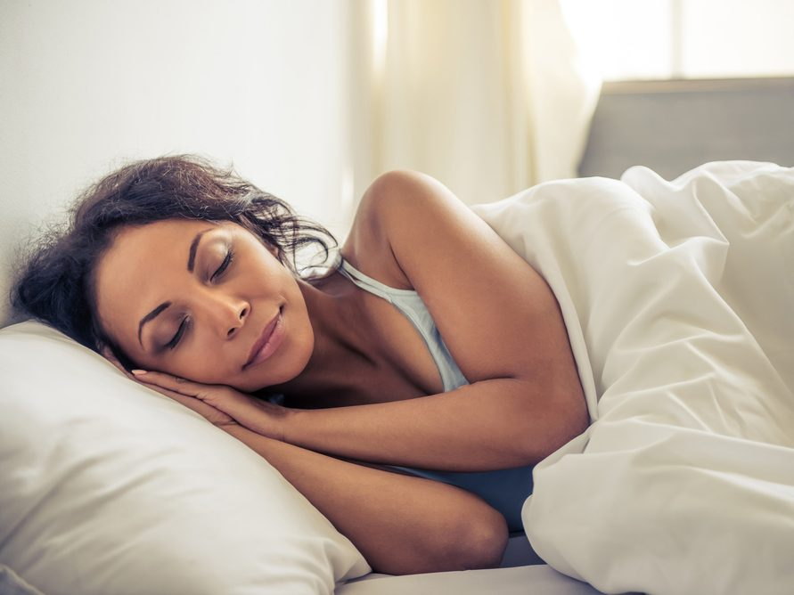 stay healthy during the holidays - woman sleeping