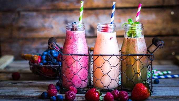 bright and colourful smoothies in milk jars