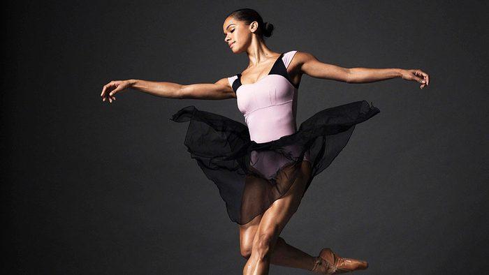Ballerina Misty Copeland mid-jump