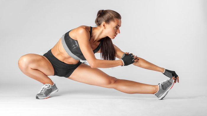 Woman wearing shorts stretching