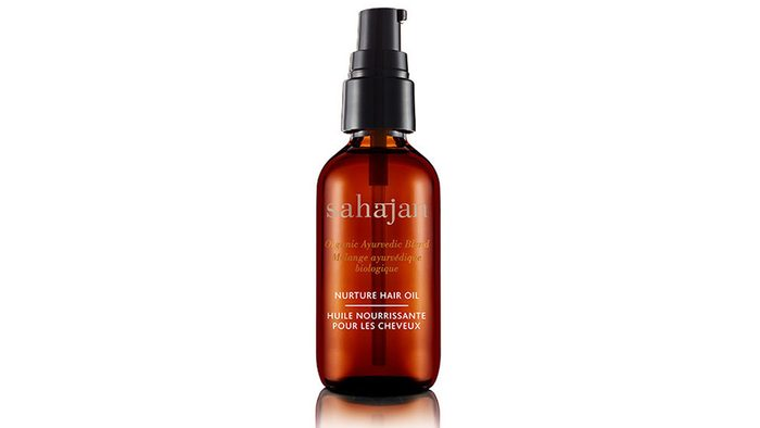 A brown bottle of hair oil