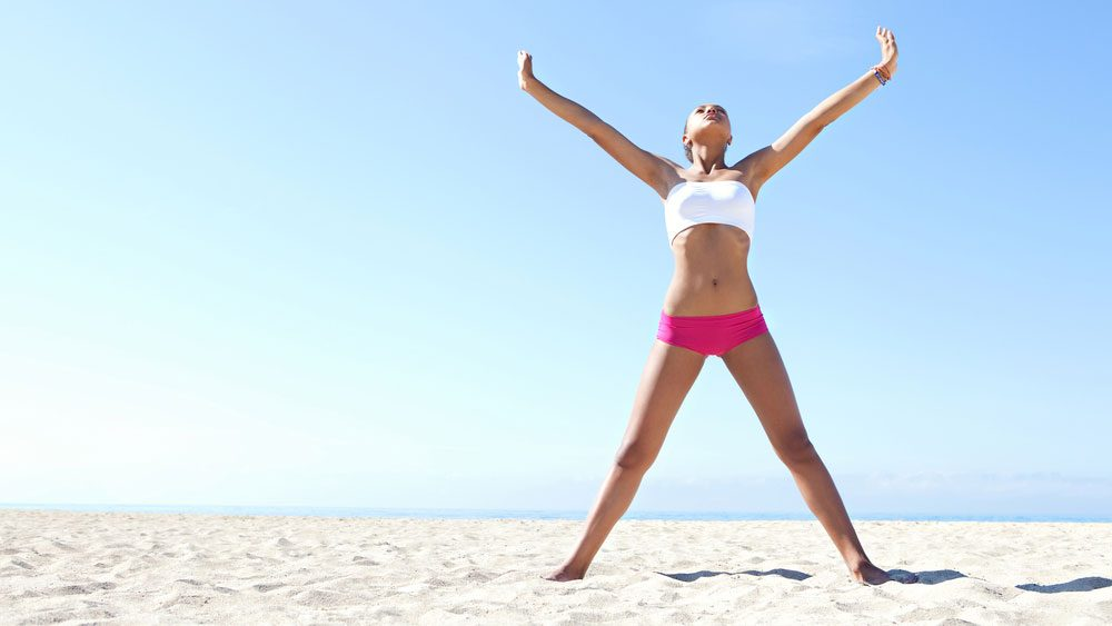 Model doing a starfish stretch with arms and legs extended