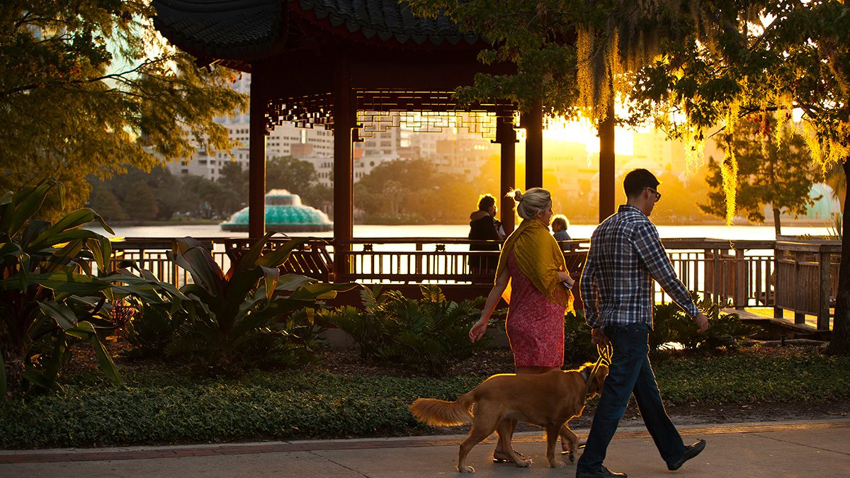 Best Health Travel Orlando couple walking on a boardwalk
