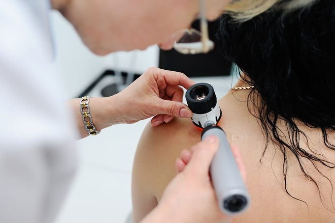 dermatologist-and-patient-skin cancer warning signs