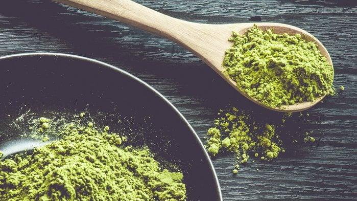 Health Benefits of Matcha: bowl and spoonful of matcha