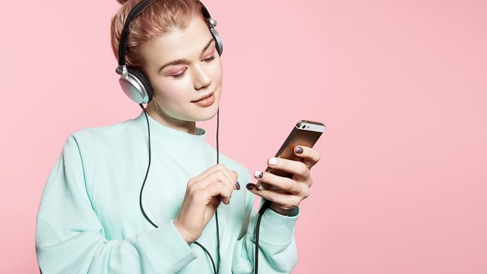 Ruining hearing: young woman with headphones on