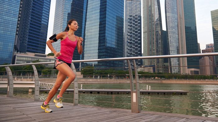 eat before a lunchtime run, a woman running near office buildings