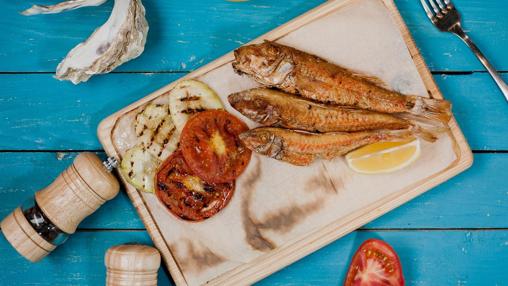 healthier barbecue fish and veggies, a platter of grilled snapper and zucchini and tomatoes