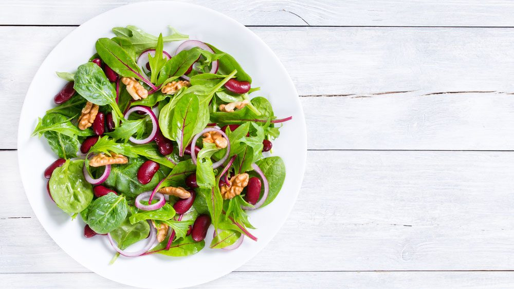nutrient deficient magnesium, a green salad with nuts and beans