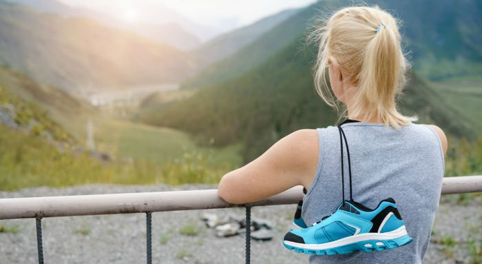 wellness getaways find purpose, woman looking into sunset after a run