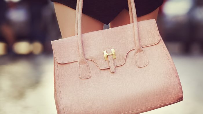 Fall wardrobe, woman holding pink leather bag