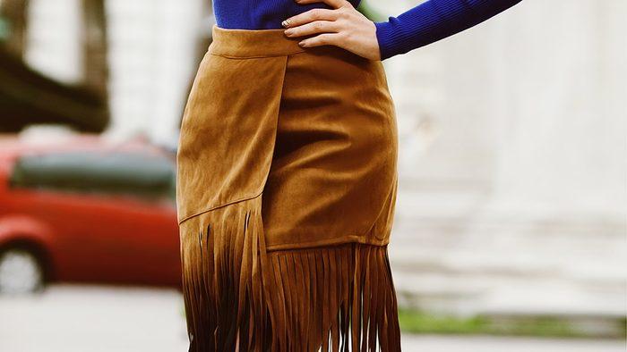 Fall wardrobe, woman wearing fringe skirt
