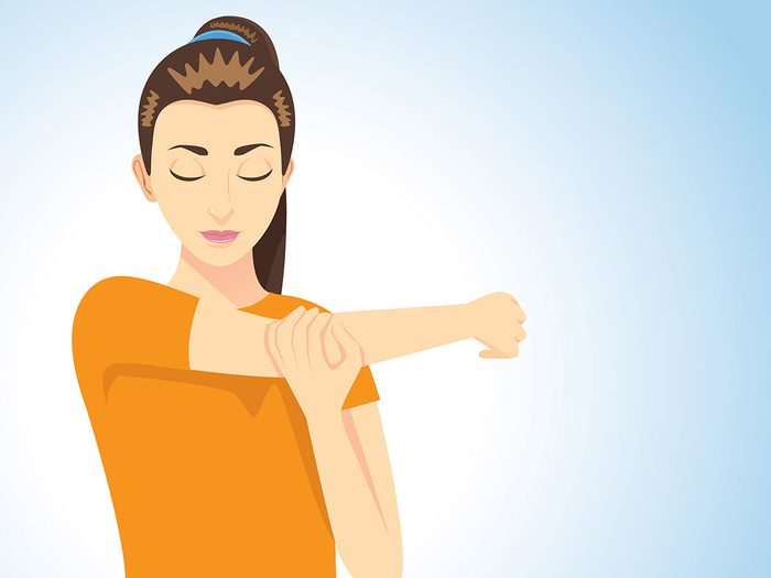 Focus on muscles, woman stretching