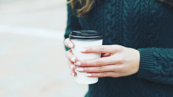 Weight loss tips, woman holding cup of green tea