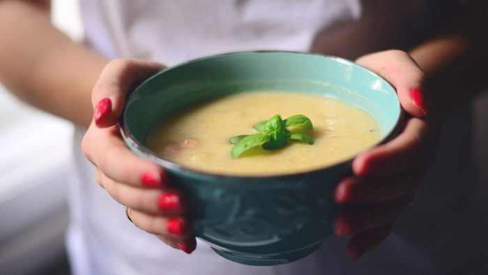 Weight loss tips, woman holding bowl of soup