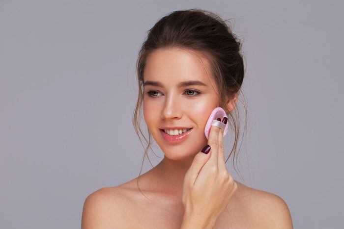 dull skin makeup mistakes, you're wearing too much makeup