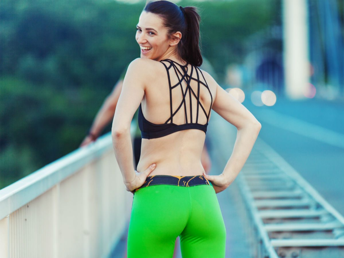 fitness and depression, a woman smiling and working out