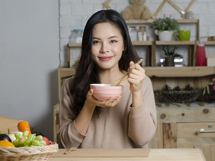 foods for great skin, a woman eating soup