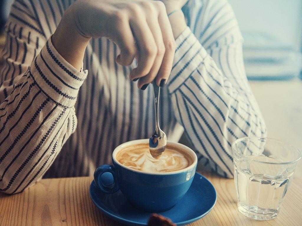 healthier coffee, woman stirring coffee