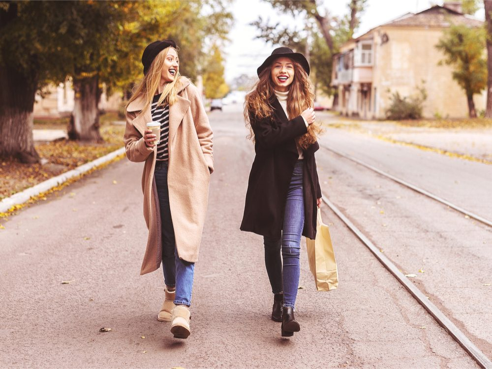 walk more coffee date, two women walking and drinking coffee