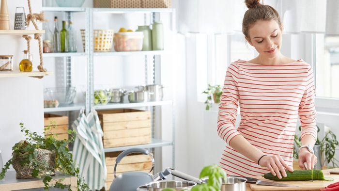 healthy kitchen appliances, woman in a beautifully lit kitchen
